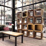 More Light: cardboard bookcase with gold leaf trims designed by Giorgio Caporaso for Lessmore. Milan Piazza Castello. DDN Phutura | Milan Design Week 2019